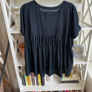 Cute black top with chiffon back